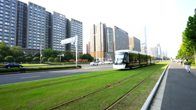 modern streetcar running in midtown of modern city