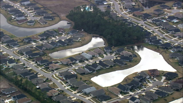 modern suburb of jacksonville - veduta aerea - florida, contea di duval, stati uniti - jacksonville florida video stock e b–roll