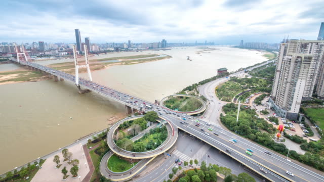 modern suspension bridge over yangtze river in nanchang in cloud sky.timelapse - suspension bridge stock videos & royalty-free footage