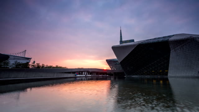 modern theater exterior and pond dusk to night,time lapse. - dusk to night stock videos and b-roll footage