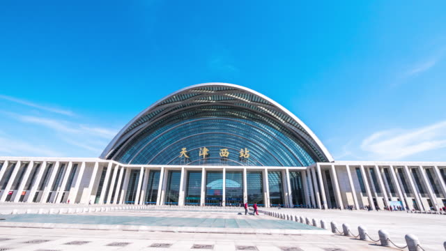 modern Tianjin West Station and Square in blue sky. timelapse 4k hyperlapse