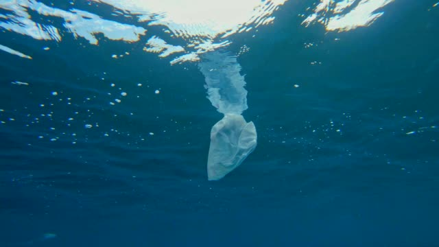 modern times symbol. plastic bag in the ocean - floating on water stock videos & royalty-free footage