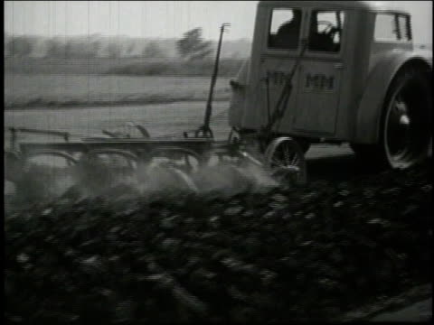 1940 ws modern tractor plowing a field / united states - 1940 stock-videos und b-roll-filmmaterial