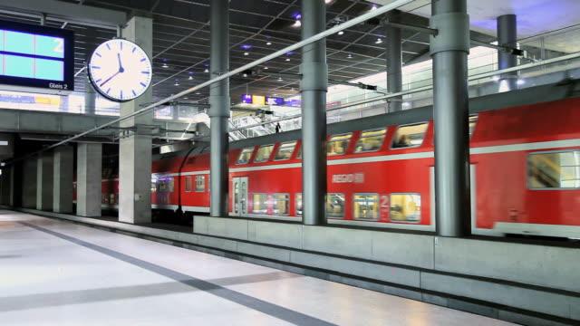 ms modern train leaving from station / berlin, germany - bahnhof stock-videos und b-roll-filmmaterial
