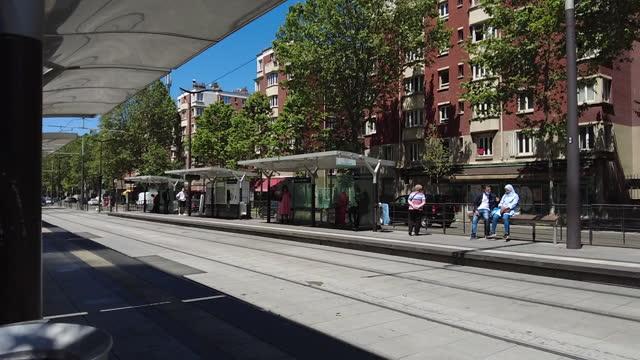modern tram on railway in paris - tram stock videos & royalty-free footage