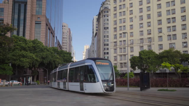 vídeos de stock, filmes e b-roll de modern tramway among tall buildings - distrito financeiro