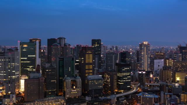 modern transportation in osaka urban cityscape time lapse / osaka, japan - 大阪駅点の映像素材/bロール