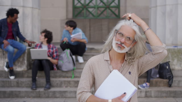 modern university professor - peluria del viso video stock e b–roll