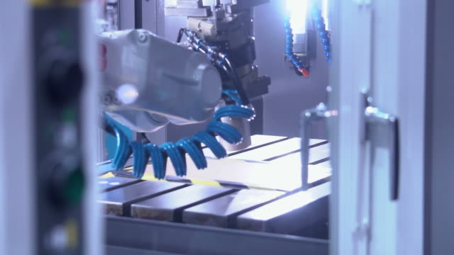 modern warehouse equipped with robotic arm - battery stock videos & royalty-free footage