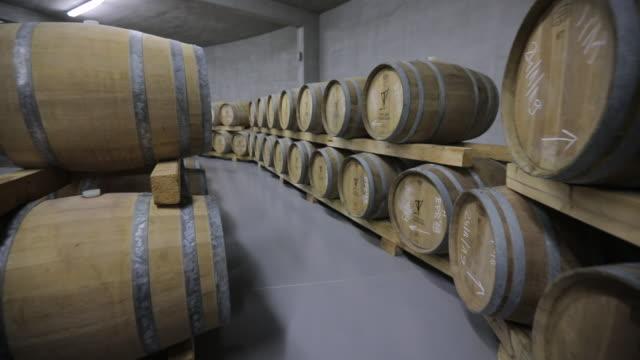 modern wine cellar full of caskets - wine cask stock videos and b-roll footage