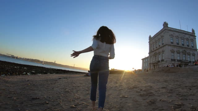 modern woman running to sunset - portugal stock videos & royalty-free footage