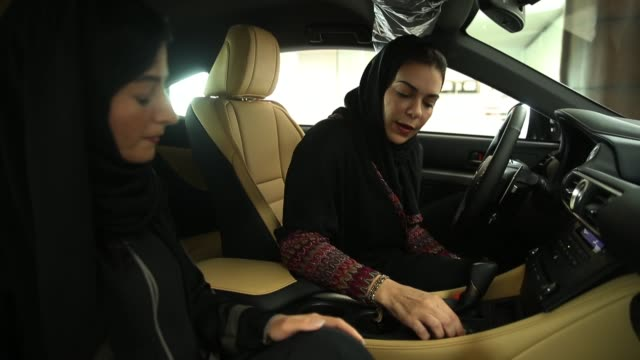 modia batterjee asks questions to saleswoman haifa alsehli while they sit in a lexus car modia is interested in buying at a lexus dealership the day... - day in the life series stock videos & royalty-free footage