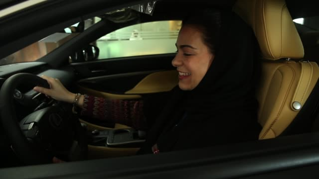 modia batterjee is interested in buying a car at a lexus dealership the day after women are once again allowed to drive in saudi arabia on june 25... - jiddah stock videos & royalty-free footage