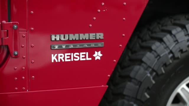 a modified electric hummer h1 sport utility vehicle stands on display at the kreisel electric gmbh research center and battery assembly plant in... - hummer stock-videos und b-roll-filmmaterial