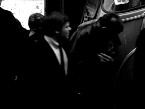 mods rockers whitsun hooligan outcome england brighton ms youths handcuffed in pairs along to coach ms coach past ms sweeping up glass on pavement ms... - window frame stock videos and b-roll footage