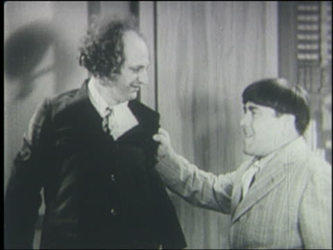 Moe slaps Larry in face then grabs his hair / The Three Stooges