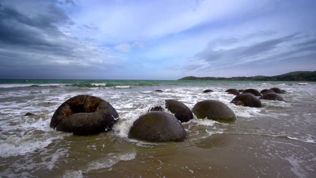 slow motion: moeraki boulders - otago region stock videos & royalty-free footage
