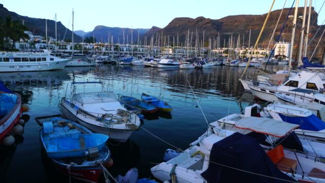 mogan harbour, mogan village, gran canaria island, canary islands, spain, europe - グランカナリア点の映像素材/bロール