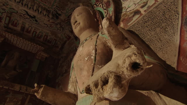 Mogao Caves South Ward The 275th Cave Buddha Maitreya with legs crossed