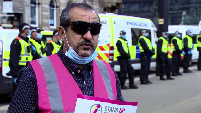 mohammad asif of stand up to racism scotland saying the protests are to send a message that glasgow says no to racism and fascism - glasgow stock videos & royalty-free footage