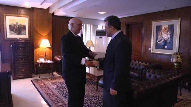 Mohammad Mousavi Secretary General of the D8 Organisation for Economic Cooperation meets with Sertac Aziz Pakistani Prime Minister Nawaz Shariff's...