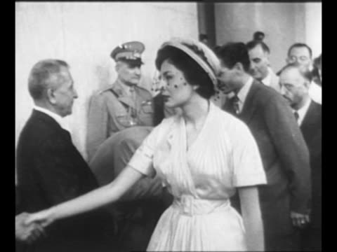 mohammad reza shah pahlavi of iran and his wife princess soraya exit hospital after minor procedure nurses line doorway soldier salutes at right /... - 1951 bildbanksvideor och videomaterial från bakom kulisserna