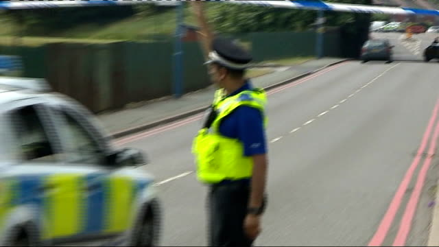 Ukrainian student charged LIB Walsall EXT Police car under cordon as along to 'Aisha Mosque and Islamic Centre' following explosion Police officers...