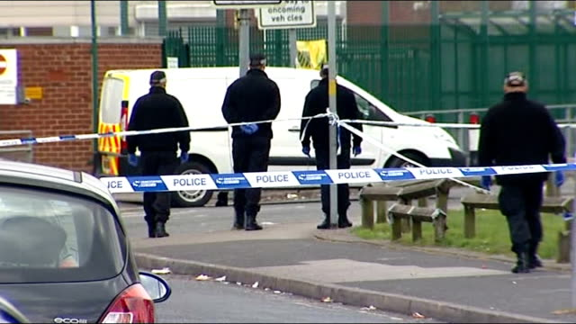 Ukrainian student charged LIB Walsall EXT Police officers and van in cordonned off area at scene of attack GV Aisha Mosque PULL OUT to police van