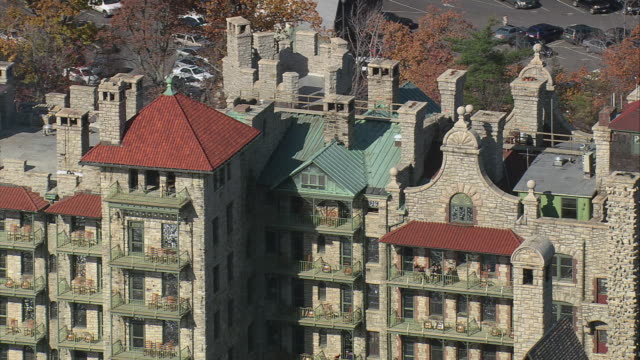 AERIAL Mohonk Mountain House facade and surrounding property / New Paltz, New York, United States