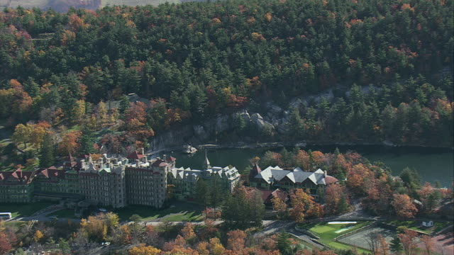 AERIAL Mohonk Mountain House overlooking Lake Mohonk / New Paltz, New York, United States