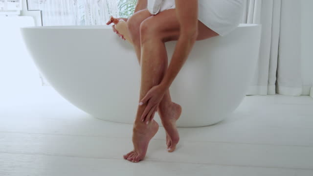 moisturizing legs - human leg stock videos & royalty-free footage