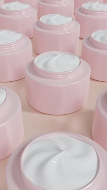 stockvideo's en b-roll-footage met moisturizing white face cream in pink bottles moves on beige background. hyaluronic acid for hydration skin. cosmetic products in jar for makeup and skincare. 3d animation, pattern. vertical web banner. - dairy product