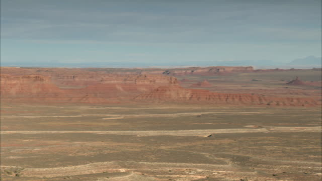 Moki Dugway in Utah looks out over a barren landscape.