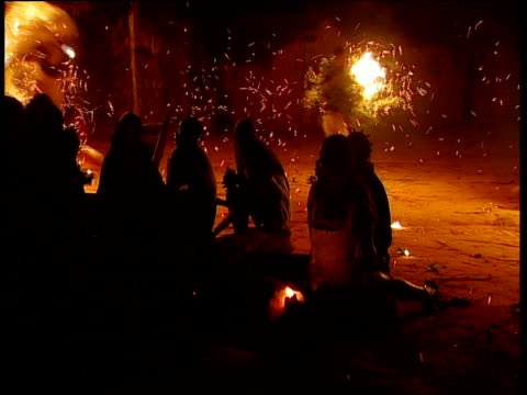 Mokoko villagers dance with flame torches to encourage hallucinations as part of Bwiti Iboga purification ritual Babongo Gabon