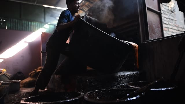 """molasses """"chaku"""" is usually prepared and consumed during the maghe sankranti festival and throughout winter by nepalese molasses """"chaku"""" in nepali is... - molasses stock videos and b-roll footage"""