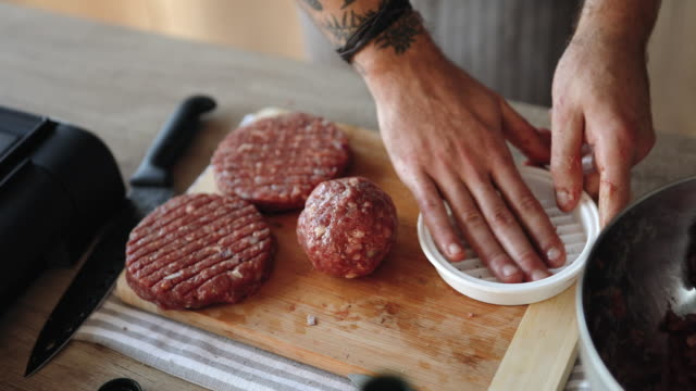 molding meat for hamburgers - preparing food stock videos & royalty-free footage