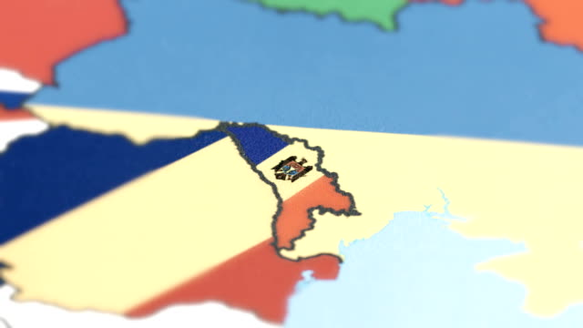 moldova with national flag on world map - moldova stock videos and b-roll footage