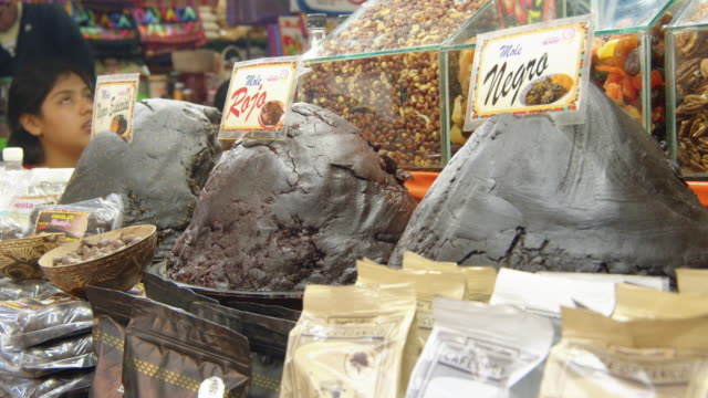 mole paste for sale at a traditional mexican food store in oaxaca, mexico - label stock videos & royalty-free footage
