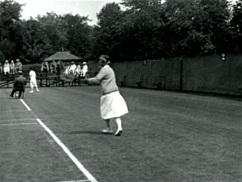 vídeos de stock, filmes e b-roll de molla mallory playing in tennis match / documentary - 1923