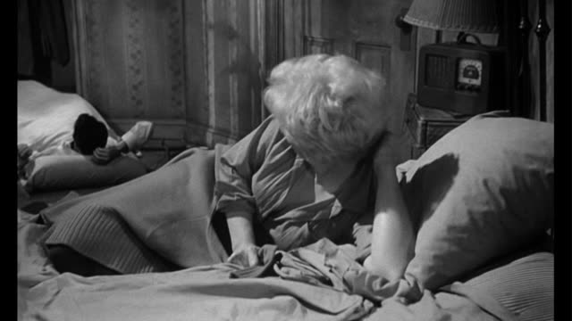 1955 Molly's (Kim Novak) suitor is upset when he sees other man (Frank Sinatra) in her apartment