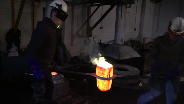 molten brass being poured into a cast at a brass foundry - foundry stock videos & royalty-free footage