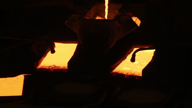 Molten copper flows into rotating molds during the production of copper cathode sheets in the copper smelting shop at the Uralelectromed OJSC Copper...