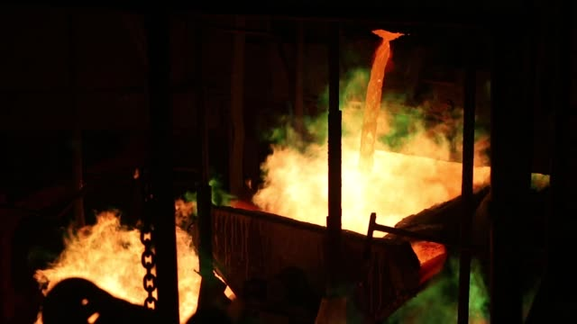 molten copper flows into rotating molds during the production of copper cathode sheets at the mmc norilsk nickel pjsc copper refinery in norilsk... - five cent coin stock videos & royalty-free footage