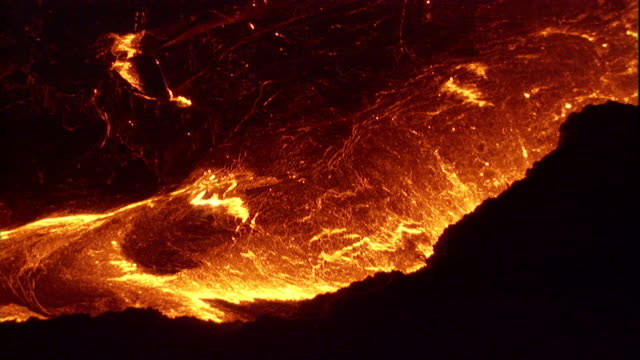 molten lava bubbles and spews inside the erta ale volcano, ethiopia. available in hd. - molten stock videos & royalty-free footage