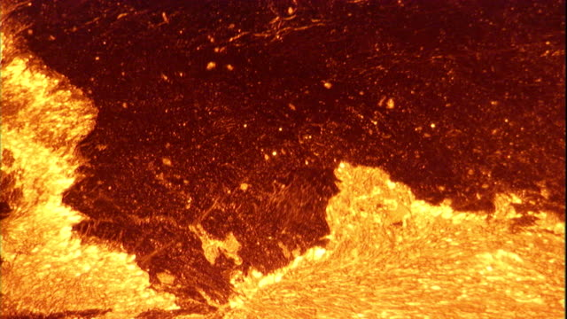 molten lava bubbles inside the erta ale volcano in the danakil depression of ethiopia. available in hd. - lava stock-videos und b-roll-filmmaterial