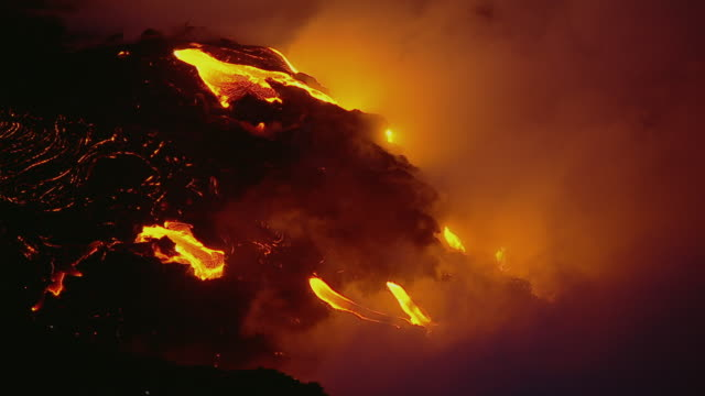 Molten lava flow in Hawaii Volcanoes National Park at night.