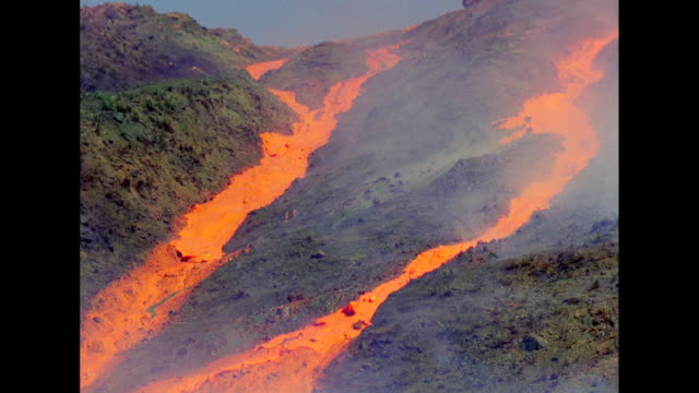 WS Molten lava flowing from hills / United States