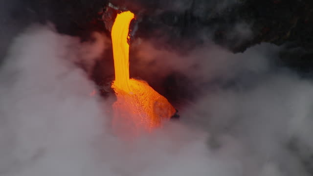 molten lava flowing into the pacific ocean from kilauea volcano on hawaii. - big island hawaii islands stock videos & royalty-free footage
