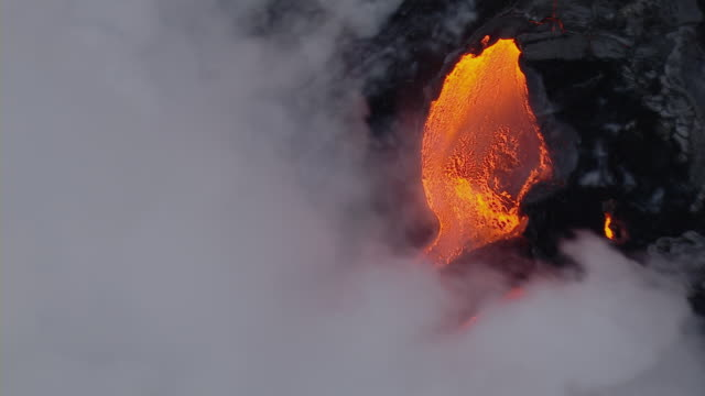Molten lava flowing into the Pacific ocean from Kilauea volcano on Hawaii.