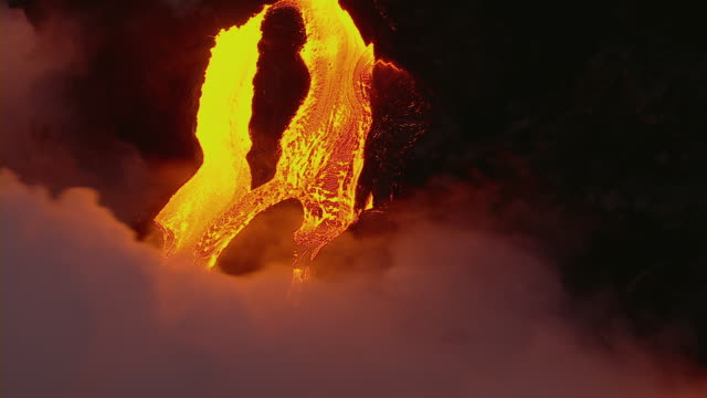 Molten lava flowing into the sea in Hawaii Volcanoes National Park.